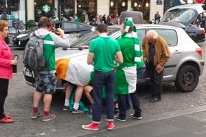 SHOCKING: Irish fans out of control in France...changing a flat tyre for a local pensioner! #IRL  #E