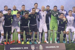 F@£k Trump: USA & Mexico players show solidarity before their World Cup qualifier last night.